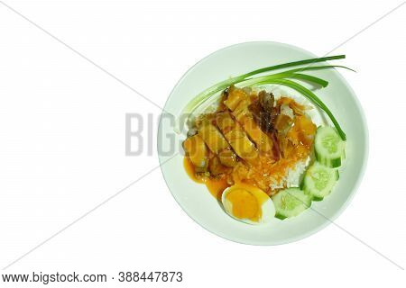 Slice Roasted And Crispy Pork With Boiled Egg  Topping On Plain Rice Dressing Sweet Red Gravy Sauce