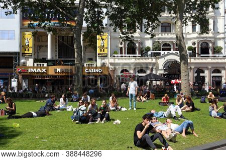London, Uk - July 7, 2016: People Visit Leicester Square In London, Uk. London Is The Most Populous