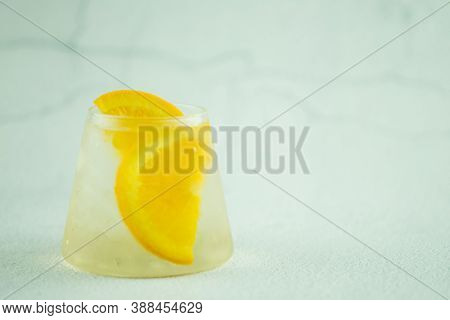 Glass Of Cool Water With Fresh Orange Slice. Summer Drink