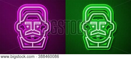 Glowing Neon Line Portrait Of Joseph Stalin Icon Isolated On Purple And Green Background. Vector