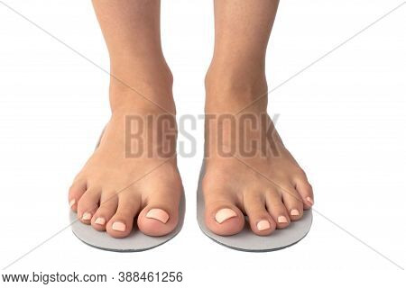 Female Feet And Insoles Isolated On A White Background.