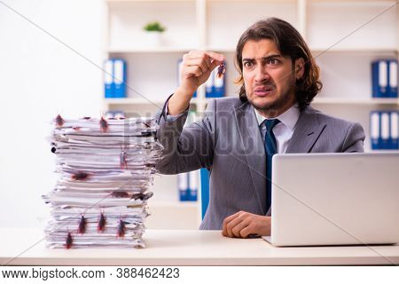 Young male employee and too many cockroaches in the office