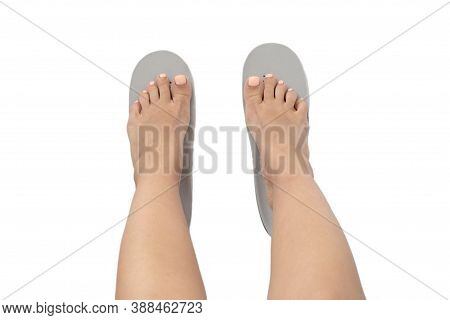 Female Feet And Insoles Isolated On A White Background. Top View.