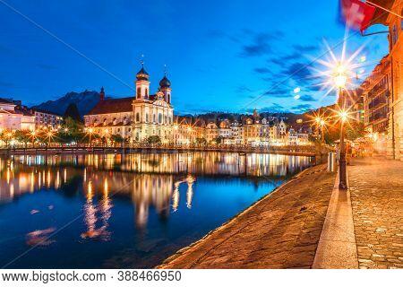 Lucerne Illuminated On Lake Lucerne, Switzerland. Jesuitenkirche Or Church Of St. Francis Xavier Ref