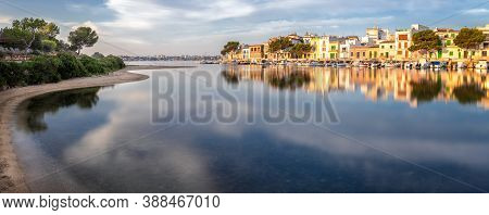 Panorama Of Portocolom Harbour With Boats, Traditional Houses And Calm Sea With Reflection, Mallorca