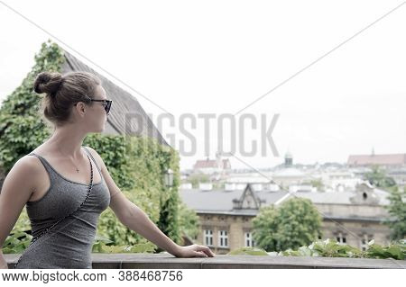 Woman Tourist Sunglasses Enjoy View Krakow Old City. Woman Stand In Front Of Architectural Horizon W