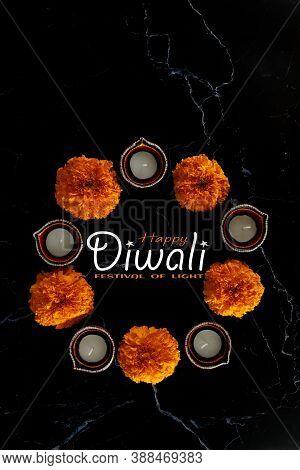 Happy Diwali - Clay Diya Lamps Lit During Dipavali With Flowers, Hindu Festival Of Lights Celebratio