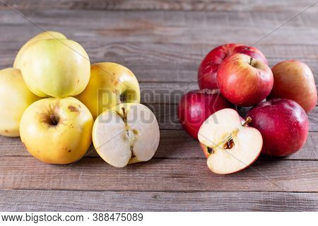 Ugly Apple In A Cut On A Wooden Background. Rotten Apple On The Wooden Background. Trend-ugliness. F