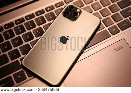 Minsk, Belarus - 30 July 2020 : New Model Apple Iphone Lies On Laptop Keyboard Closeup. Illustrative