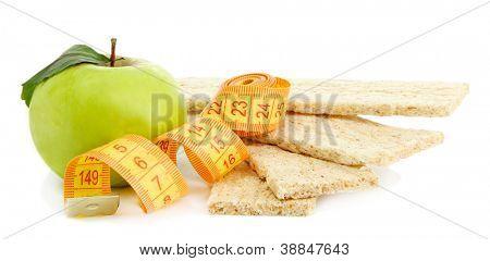 tasty crispbread, apple and measuring tape, isolated on white
