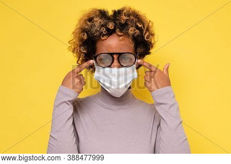 African American Woman With Foggy Glasses Caused By Wearing A Covid Protective Mask