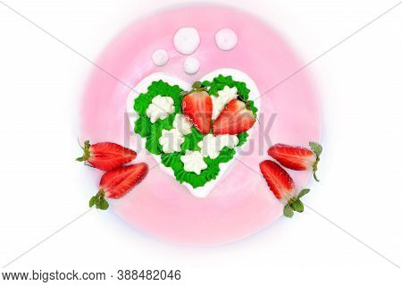 Meringue On A Pink Plate With Strawberries. Dessert In The Form Of Hearts With Cream. Green Custard