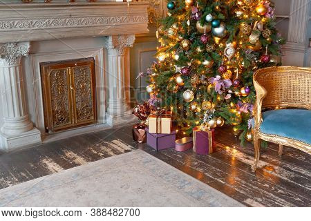 Classic Christmas New Year Decorated Interior Room Fireplace New Year Tree. Christmas Tree With Gold