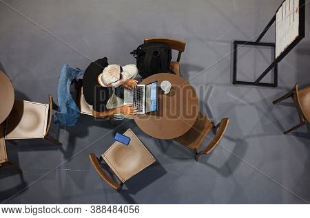 Trieste, Italy - September, 06: Top View Of A Man Sitting At Table Working With His Notebook In The