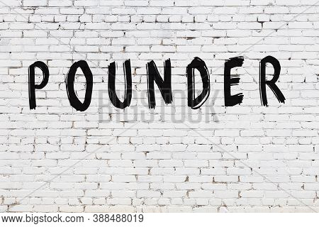 White Brick Wall With Inscription Pounder Handwritten With Black Paint
