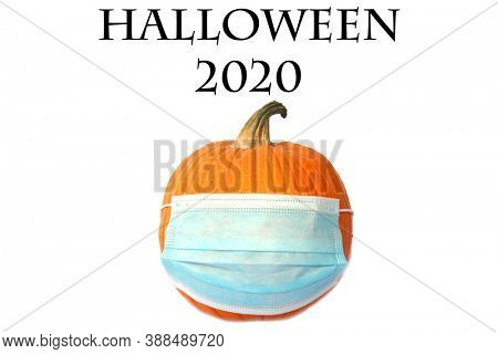 Halloween Pumpkin. Halloween Pumpkin with a Medical Face Mask to represent Coronavirus Caution this Halloween. Face Masks are an important way to stay safe from Covid-19. Isolated on white.