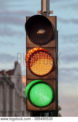 Traffic Light. Green Road Signal. Intersection Control For Transport. Yellow Trafficlight On Roadway