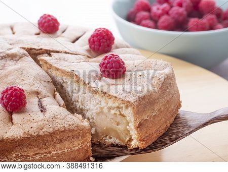 Slices Of Homemade Raspberry Pie And A Bowl Of Fresh Berries