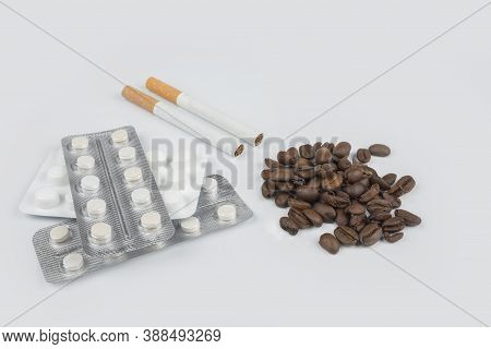 Bad Lifestyle. Cigarette Coffee And Pills Concept