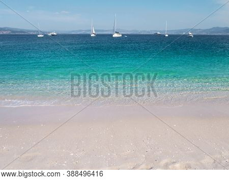 Turquoise Sea And White Sandy Rodas Beach At The Cies Islands, Galicia, Spain. Crystal Clear Shallow