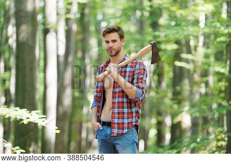 Modern Logger. Ranch Man Carry Axe. Sexy Guy Wear Unbuttoned Shirt In Forest. Male Power And Energy.