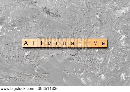 Alternative Word Written On Wood Block. Alternative Text On Table, Concept