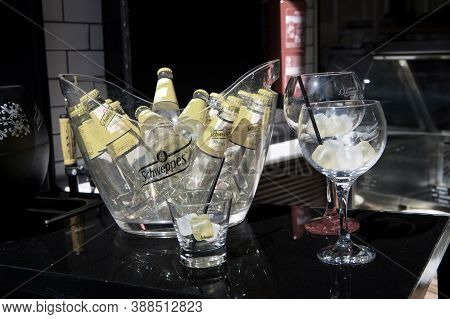 Key West, Fl, Usa - March 30, 2016: Schweppes Tonic Water Bottles Yellow Color In Glass With Cold Ic