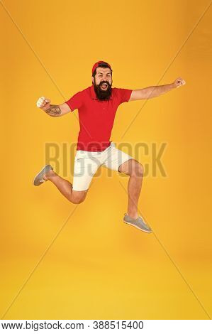 Towards Fun. Enjoying Active Lifestyle. Happy Guy Jumping. Active Bearded Man In Motion Yellow Backg