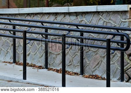 Ramp For Wheelchair Entry With Metal Handrails Close-up