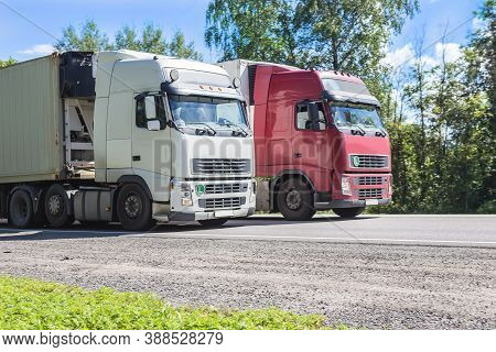 Trucks Transporting Freight On The Country Highway