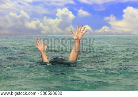 Drowning Man Hands Stretched Out To The Surface For Help At Sea