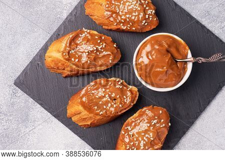 Sandwiches With Baguette Of Bread Spread With Sweet Paste Of Boiled Condensed Milk
