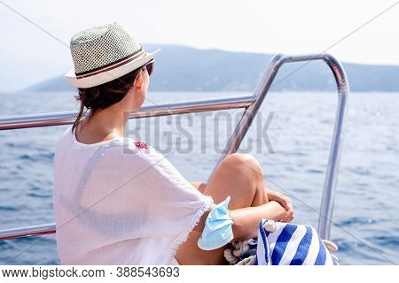 Beautiful Woman On Boat In Vacation. Vacations Lifestyle. Woman Relaxing On The Boat.. Beautiful Wom
