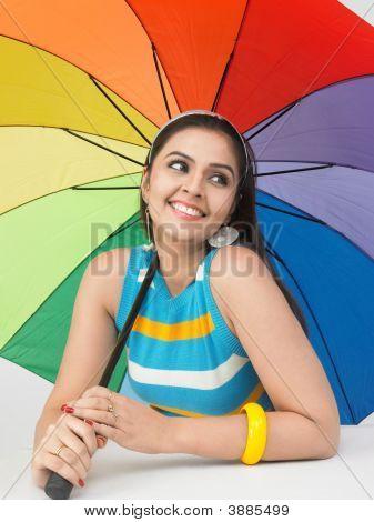 Asian Woman With A Rainbow Umbrella