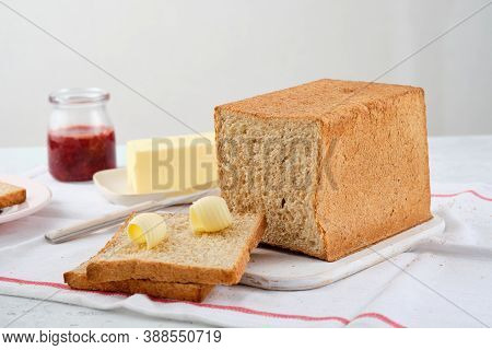 Butter Curl On Toast Bread. Healthy Breakfast With Bran Bread Toast, Butter And Jam.
