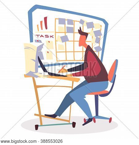 Man Sitting On Chair By Table In Office With Laptop. Person Working, Typing On Computer And Has Lot