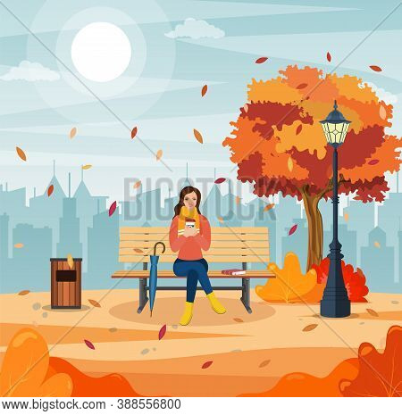 Happy Girl Sitting On A Bench With A Cup Of Coffee, Under A Tree With Falling Leaves In A Park. Beau