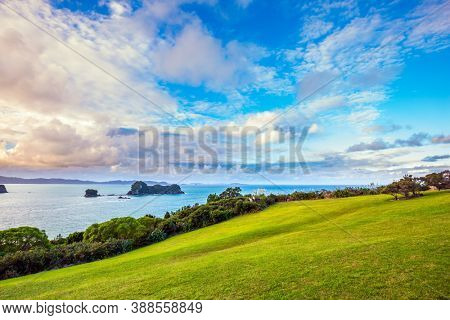 Road to the cove. Incredible clouds over the evening tide. Pacific Ocean, New Zealand. Cathedral Cove on the North Island. The concept of active, exotic, ecological and photo tourism