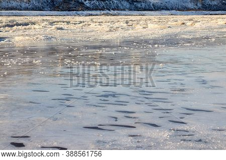Sparkling Ice Texture Or Background. Ice Hummock On Frozen River In Winter Sunny Day.