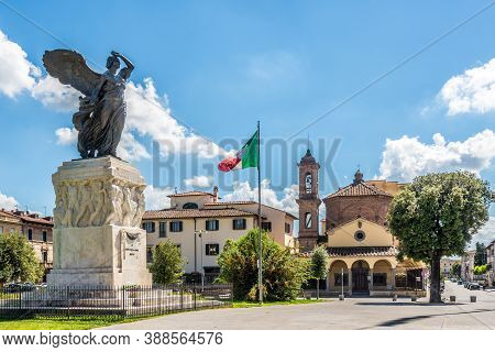 Empoli,italy - September 6,2020 - View At The War Memorial With Church Of Del Pozzo In The Backgroun