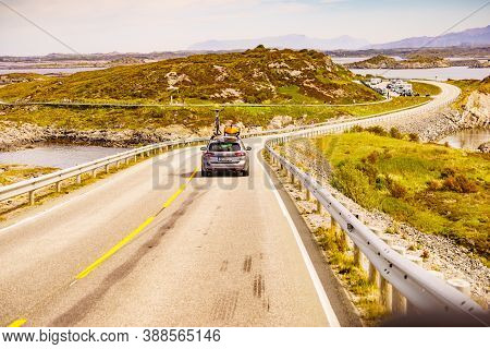 Atlantic Road, Norway - July 11, 2018: Car With Recreational Equipment Bicycle And Canoe On Roof Dri