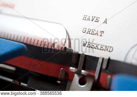 Have a great weekend phrase written with a typewriter.