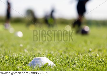 Blurred Background Of Training Soccer Field. Sports Soccer Grass Venue. Training Football Marker On