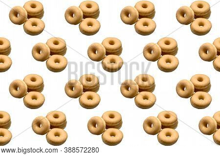 Repetition Of Classic Donuts On A White Background. Copy Space. Concept Publicity, Sweets.