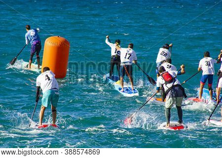 04 Oct 2020: Garraf, Spain. Stand Up Paddle Surfing Or Sup Race Competition. The Competition Has Beg