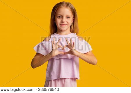 Love Sign. Supportive Kid. Affection Sympathy. Compassion Encouragement. Cheerful Little Girl In Pin