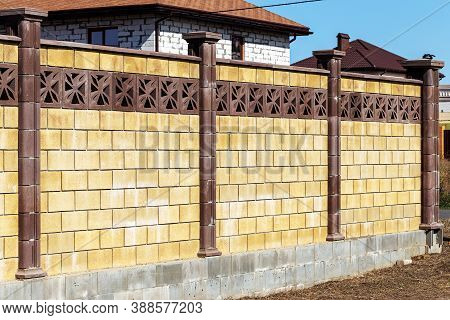 Prefabricated Concrete, Stone, Brick New Modern Expensive Outdoor Fence To Street. Wall Of Fence Is