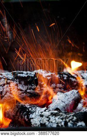 Sparking Balefire With Flames Light. Wood Campfire. Fireplace. Bonfire Closeup. Fire And Firewood Tu