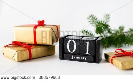 January 1st. Day 1 Of January Month, Calendar With Gift Boxes And Fir Branches On White Background.