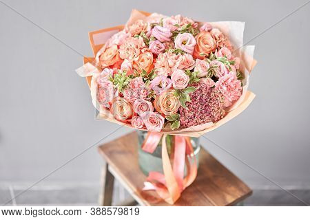 Bouquet Peach And Orange Color. Beautiful Bunch Mixed Flowers In Wooden Table. The Work Of The Flori